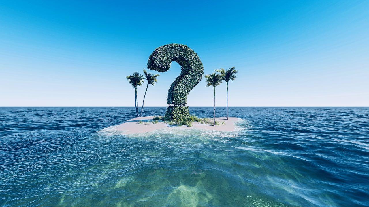 Kuvassa kysymysmerkki autiolla saarella.