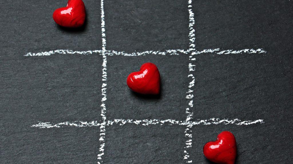 Koristeellinen kuva, jossa sydämiä peliruudukossa